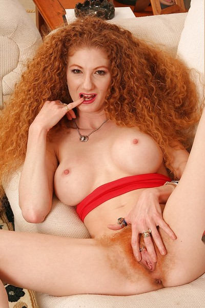 Redhead MILF with unshaven bawdy cleft Annie Body undressing and widening her legs