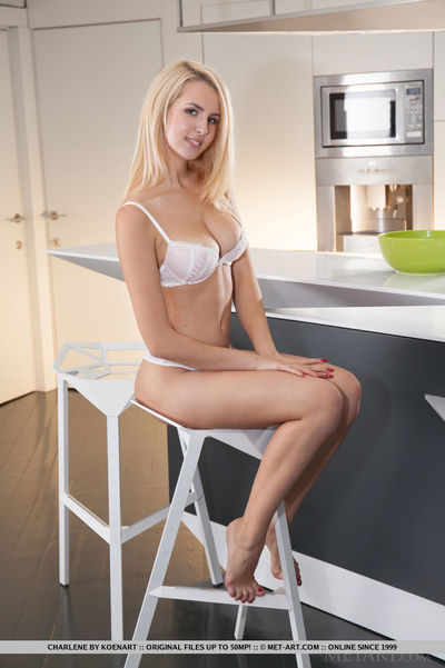 Curvy golden-haired glamour darling unveiling bald youthful muff in kitchen
