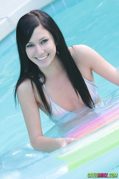 Soggy smooth head cum-hole juvenile catie minx swimming in the pool uncovered