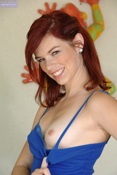 Smiley redhead chicito undressing and exposing her spectacular bawdy cleft in close up