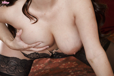 Alluring pornstar lovely off her lacy underware and toying her pink cage of love