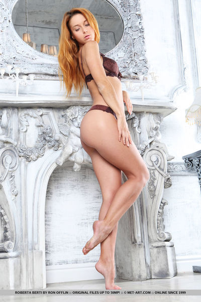 Redheaded Euro cutie Roberta Berti displaying cool infant waste for glamour pictures