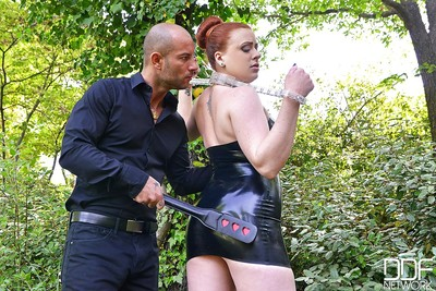 European redhead Isabel Dean takes part in an Bondage scene outdoor