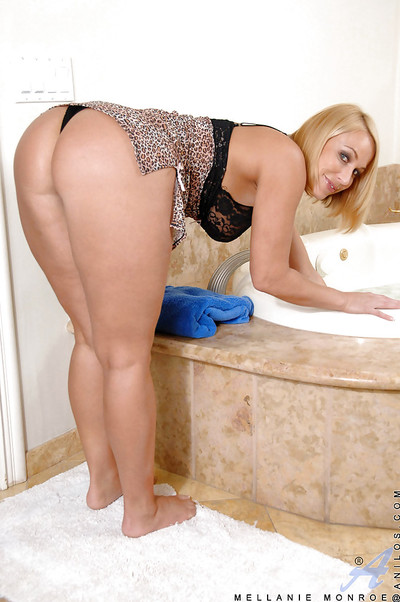 Appealing babe Mellanie Monroe making her twat soggy and aroused in the shower-room