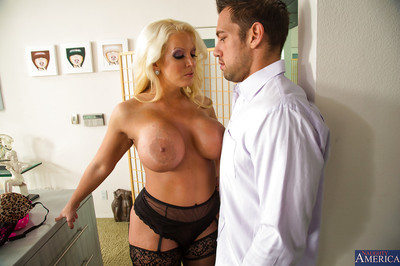 Sultry MILF with giant enhanced jugs gives a titjob and benefits from dug rough