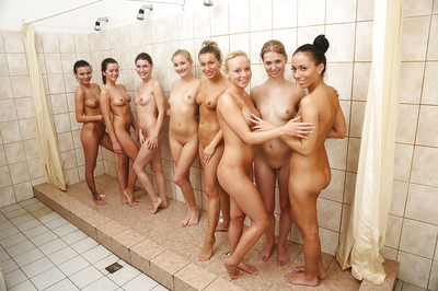Attractive Nessy and her girl-on-girl supporters wanking in the shower-room
