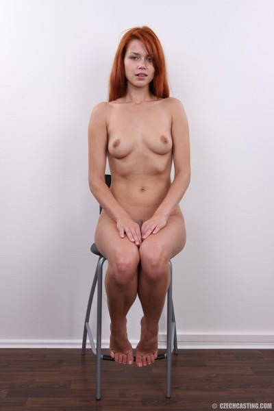 Alluring redhead amateur positions bare