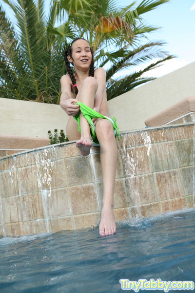 Slutty oriental cutie swimming in unclothed
