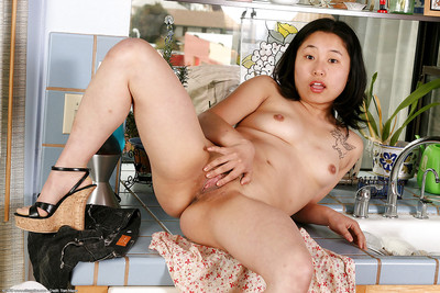 Infant Chinese hottie Small baring bumpers and playing with dick in kitchen