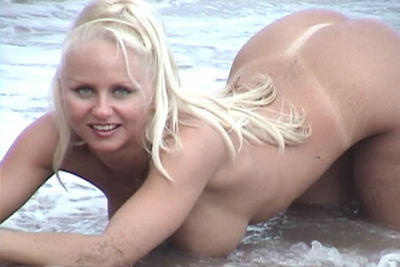 Breasty blond angel Trixie frollicks unclothed on the beach