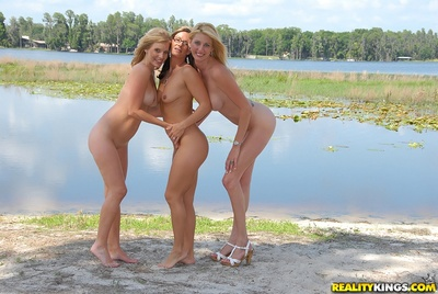 3 girl-on-girl MILFs flaunting bare outdoor