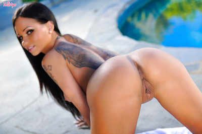Considerate brunette hair darling Raven Bay shows her concealed tattoos