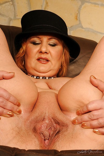 Fatty adult with large billibongs amplifying her legs showing her damp muff