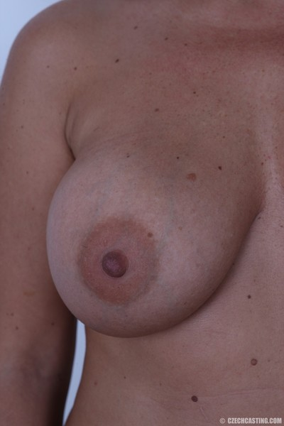 Titsy ripe milf shows off her appealing body