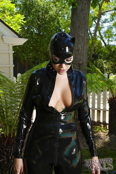 Purty angel in latex outfit Emily Parker pours milf on her bra buddies