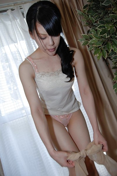Chinese brown hair lass Ruriko Furuse gets undressed her hose and shows cage of love