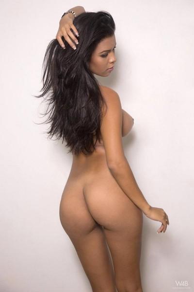 Rounded erotic brunette hair posing topless