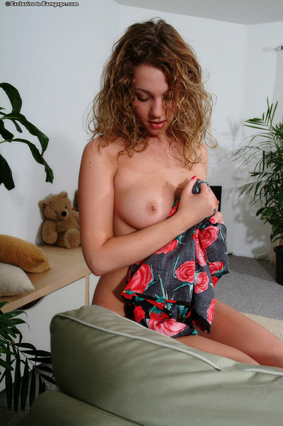 Curly-haired young sugar-plum getting exposed and swelling her smooth head muff