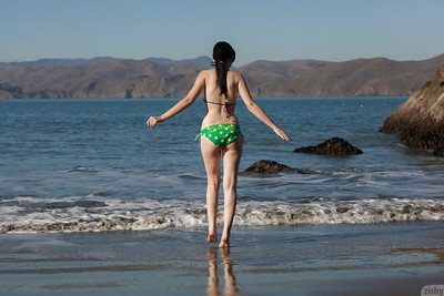 Pale skinned juvenile cutie Paris Moffer jacking off her love button on the beach