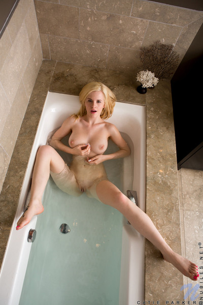 Untamed youthful catie parker soaks her rigid cunt in a bathroom