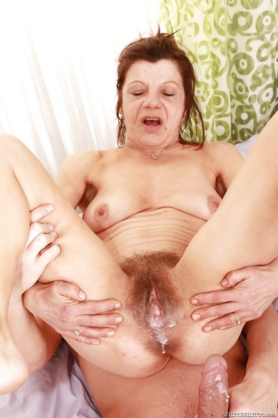 Lascivious mature gives a cocksucking and receives her bush slammed and creampied