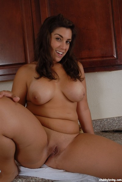 Busty Latin babe cutie Leigh letting weighty normal milk sacks loose in kitchen