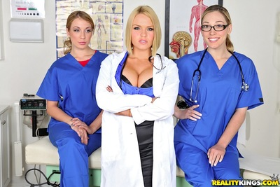 Fuckable nurses in uniform giving a kiss and flashing their asses and wet cracks