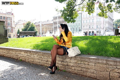 Happy dark brown in  flashing her goods in public places