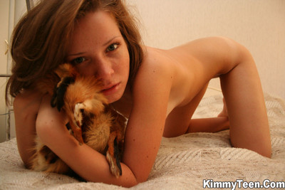 Moist kimmy is enjoying her fox fur all over her body