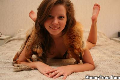 Moist kimmy is enjoying her fox fur all over her body
