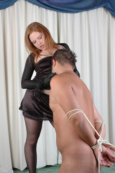 Appealing female-dominant strings up bond and pulls down her cylinder so this boy c