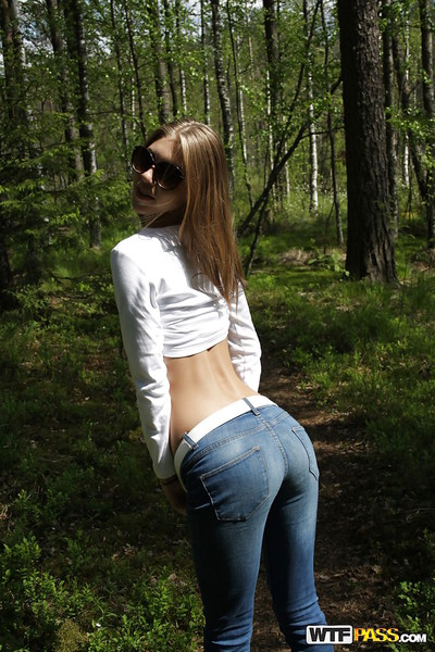 Slippy long-haired young flashing her small love muffins outdoor