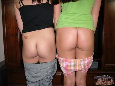 2 young fresh chicks pulling down strings - erin & kirin from trueamateurmodels.com
