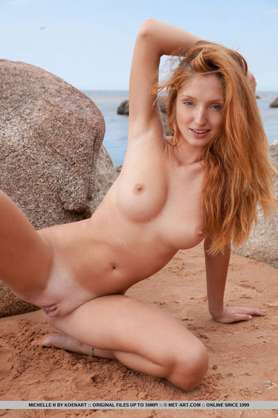 Euro hotty Michelle H showing off nice infant booty on beach for glamour pictures