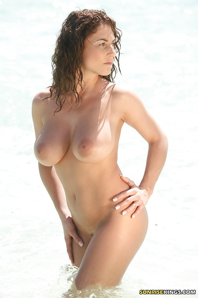 Gigantic titted pornstar Roberta Misoni flaunting undressed on the beach