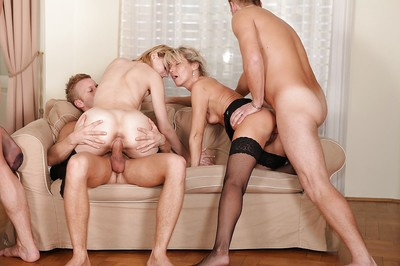 Concupiscent MILF in stockings have a obsessive once in a time penetration group sex with hung boyz