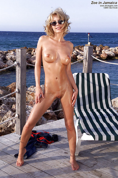 Blond beach dear Zoe puts on sunglasses and takes off Master outdoors