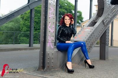 Redhead in shiny latex
