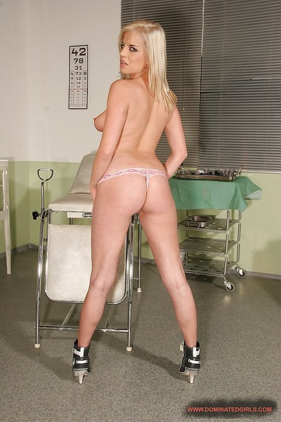 Breasty fairy-haired girl on high heels erotic dancing off her nurse uniform