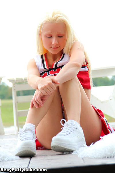 Little fairy-haired teasing and striptease in cheerleader uniform