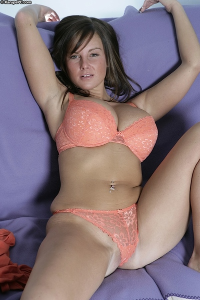 Top-heavy dark brown youthful undressing and fingering her gash