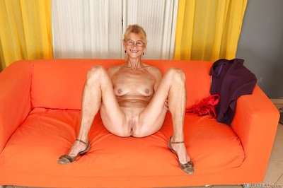 Lecherous adult with skinhead pussy erotic dancing and amplifying her legs
