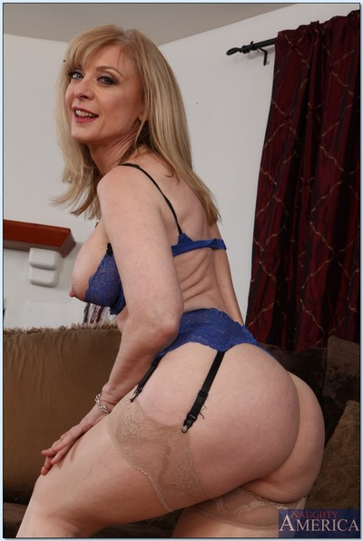 Seductive ready lady Nina Hartley slipping off her clothing and underclothes