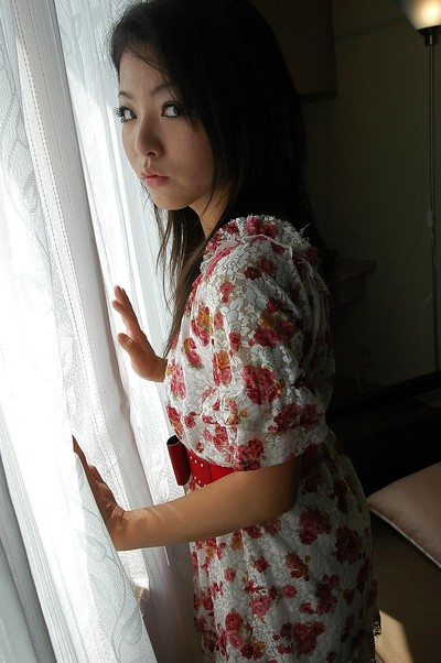 Eastern young Nao Miyazaki undressing and exposing her gentile in close up
