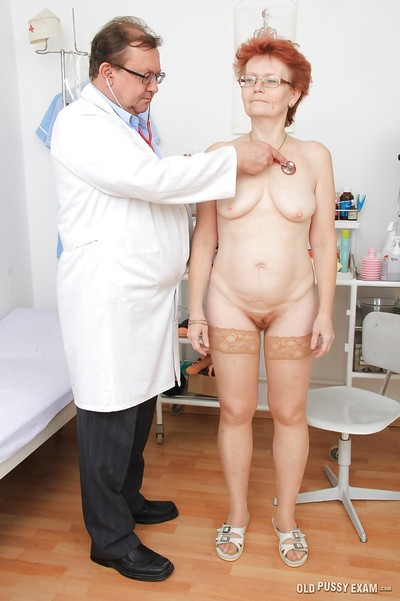 Redhead mellow lady in glasses going throughout complete gyno examinations