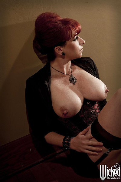 Sassy redhead MILF in hawt girdle exposing her jugs and teasing her gentile