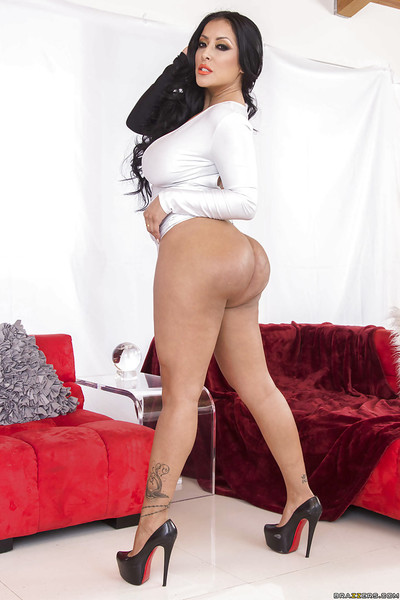 Concupiscent pornstar Kiara Mia is showing off in her swarthy and white costume