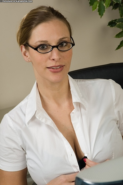 Lascivious MILF disrobes to show her immense milk cans and entered love button in the office