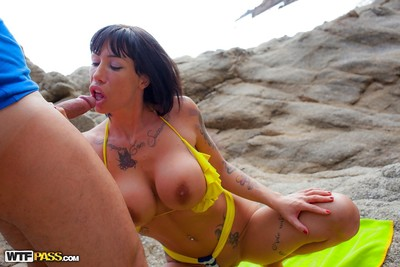 Inked infant emancipate large billibongs from bikini on beach in advance of giving oral play