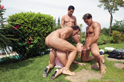 Golden-haired princess has an outdoors appealing group sex with 3 huge rods